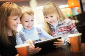 family on tablet in coffee shop blog