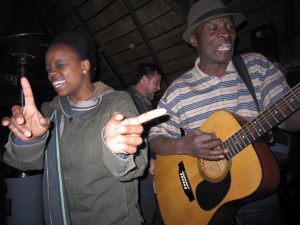 Lerato (LoveLife) dancing with Soweto restaurant musician