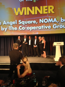 Ben Du Boulay, director, The Carlyle Group presenting the award for Commercial Development of the Year to The Co-operative Group